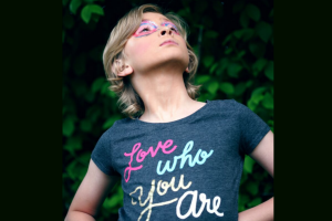 young person wearing a tshirt that reads love who you are