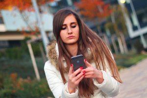 girl using her phone