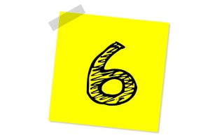 The number six drawn on a yellow post-it