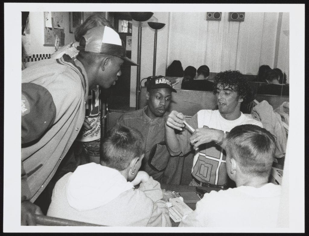Group of young men at a sex education session, 1990s
