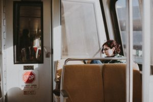 young person sitting on a train